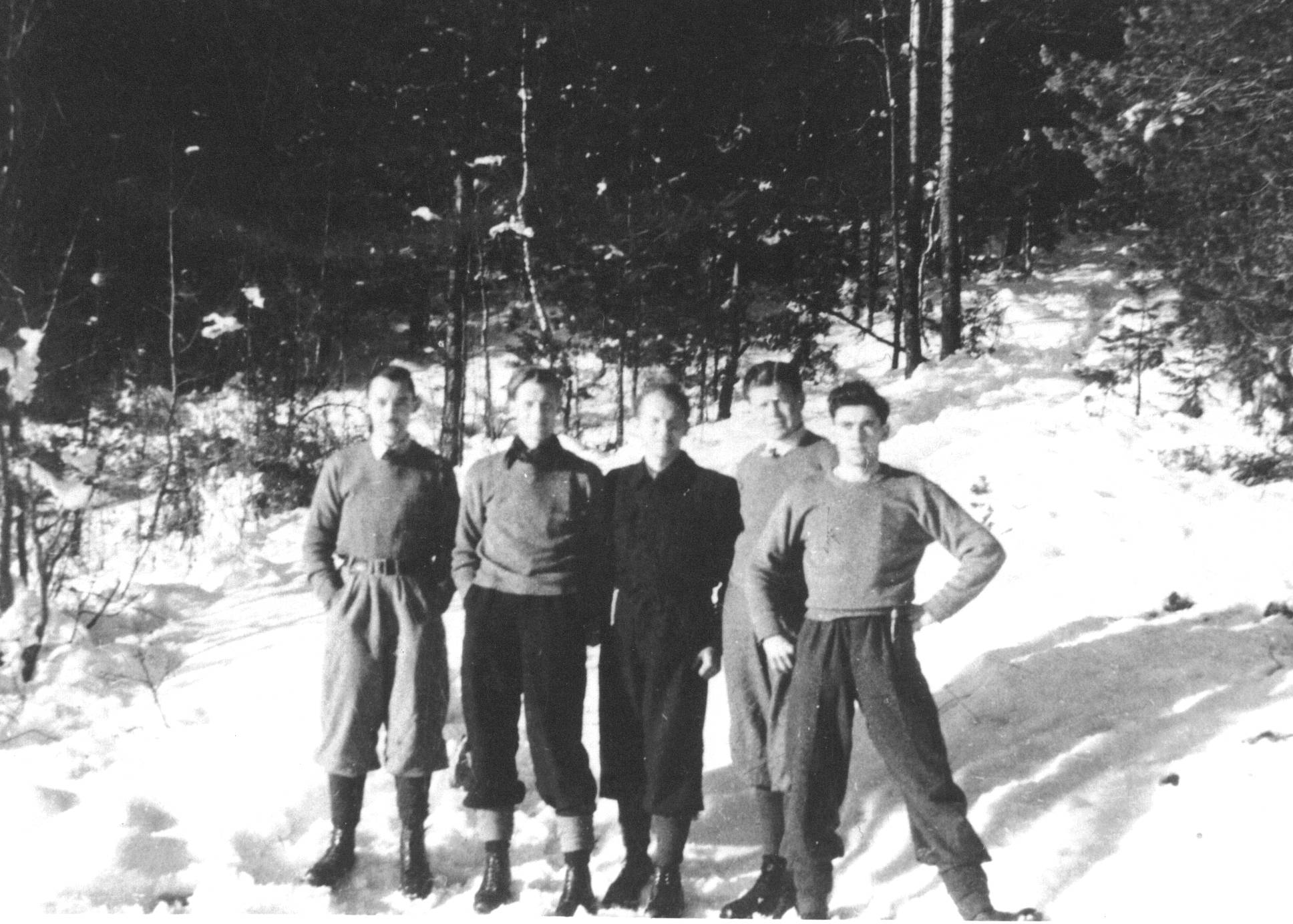 Evaders Bolton, Dalton, Chapin and Hicks with a Norwegian helper [centre]. On a supply drop to a Mil Org group in the Telemark region the Crew's Stirling iced-up and crashed. The surviving crew reached Sweden by an overland route.